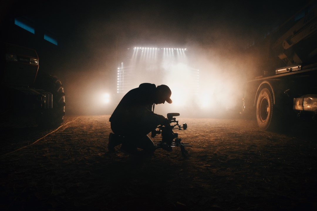 Man filming in the dark